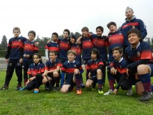 Equipo de Benjamines del Club de Rugby de Majadahonda al finalizar el partido