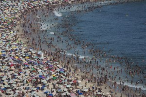Thousands of beach goers pack Ipanema beach in Rio de Janeiro, Brazil, Sunday, Dec. 28, 2014. With temperatures reaching over 40 degrees celsius,Rio beaches were packed on the last weekend of the year.