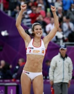 Spain's Elsa Baquerizo McMillan celebrates after they won their women's preliminary round beach volleyball match against Argentina at the London 2012 Olympic Games at Horse Guards Parade July 31, 2012. REUTERS/Lucy Nicholson (BRITAIN - Tags: SPORT OLYMPICS SPORT VOLLEYBALL)