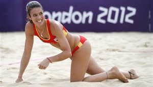 Spain's Elsa Baquerizo reacts after missing the ball during a beach volleyball match against United States' April Ross and Marleen Kessy at the 2012 Summer Olympics, London, Thursday, Aug. 2, 2012. (AP Photo/Jae C. Hong)