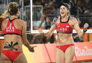 USA's April Ross (L) and Kerri Walsh Jennings celebrate after winning a point during the women's beach volleyball bronze medal match between Brazil and the USA at the Beach Volley Arena in Rio de Janeiro on August 17, 2016, for the Rio 2016 Olympic Games. / AFP / Leon NEAL (Photo credit should read LEON NEAL/AFP/Getty Images)